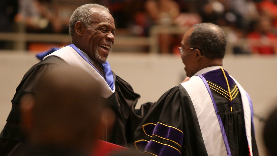 Bishop Henry Williamson, right, moves to give actor