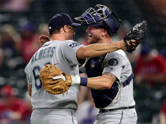 Mike Marjama, right, with starter Andrew Albers, is