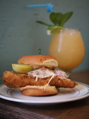 The crispy whitefish sandwich from Voyager in Ferndale is made of beer-battered Lake Superior Whitefish, lightly fermented cabbage slaw with coconut milk, a brioche bun and McClure's pickle wedge.