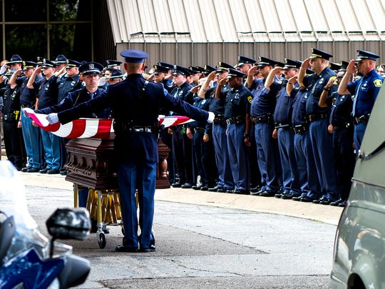 Last honors are paid to Lt. Joseph Zangaro, a retired Michigan State Police Bridgman post commander, one of two court bailiffs gunned down by a prisoner inside the Berrien County Courthouse on Monday. The prisoner was also killed. About 1,500 people attended the funeral service for Zangaro at the Lake Michigan College Mendel Center on Friday, July 15, 2016.