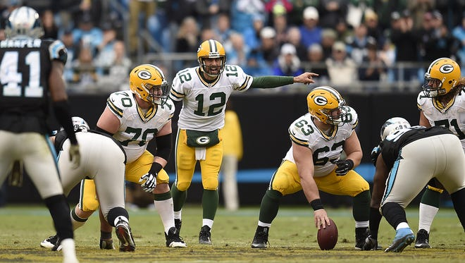 Green Bay Packers quarterback Aaron Rodgers (12) shouts instructions to his teammates at the line of scrimmage during Sunday's game against the Carolina Panthers at Bank of America Stadium in Charlotte, NC.
