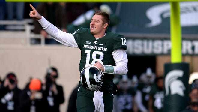 Connor Cook (18) runs out onto the field during Senior Day festivities before MSU's 55-16 win over Penn State on Nov. 28 at Spartan Stadium in East Lansing.