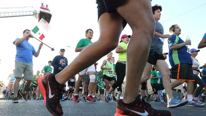Runners set out on the 2nd Annual Run International U.S-Mexico 10K run in 2016.