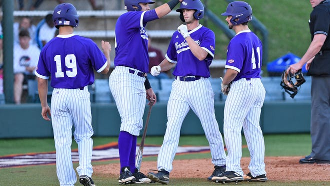 Northwestern State's Tyler Smith is congratulated during Wednesday night's game.