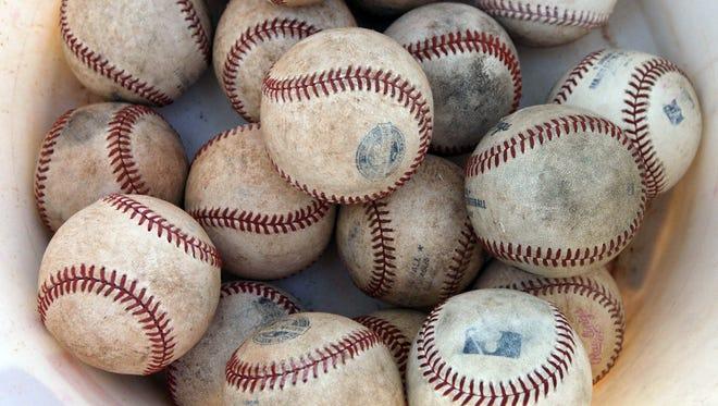 A bucket of major league baseballs.