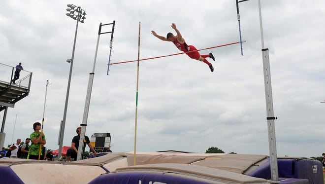 Olney's Wyat Burrows clears the bar in the pole vault Thursday, April 20, 2017, at the District 9 and 10 Area Meet in Jacksboro.