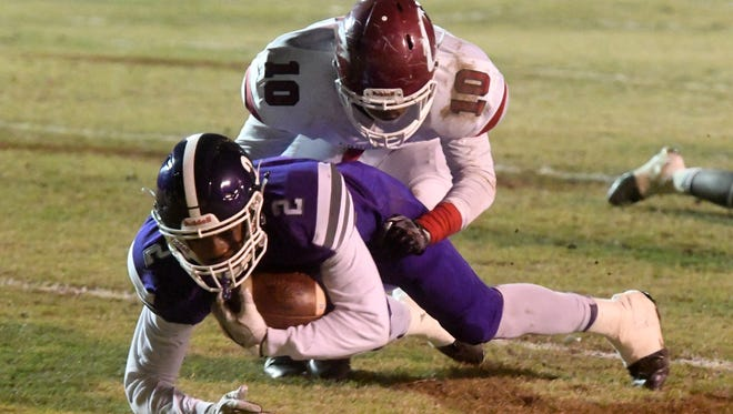 Haywood's Deyondrius Hines is tackled from behind by Crockett County's Kerrington Parker as he crosses the end zone during their game, Friday, November 17.
