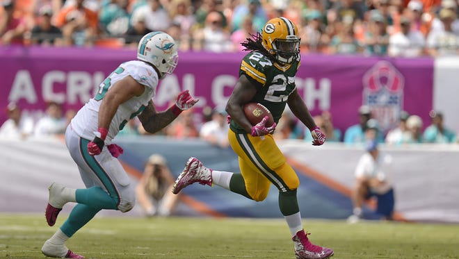 Green Bay Packers running back Eddie Lacy (27) tries to elude Miami Dolphins linebacker Koa Misi (55) while making a run in the second quarter during Sunday's game at Sun Life Stadium in Miami, FL. Evan Siegle/Press-Gazette Media