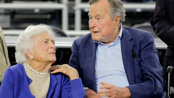 "In this March 29, 2015, file photo, former President George H.W. Bush and his wife Barbara Bush, left, speak before a college basketball regional final game between Gonzaga and Duke, in the NCAA basketball tournament in Houston. A family spokesman said on April 15, 2018, that the former first lady Barbara Bush is in ""failing health"" and won't seek additional medical treatment."