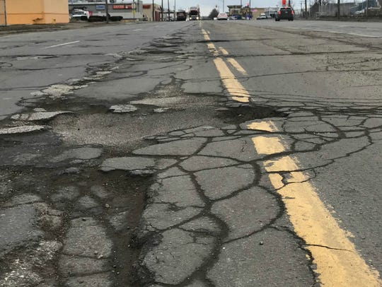 A gaping 45-inch-long hole in the middle of Wyoming Street, between Mercier and Eagle, in Dearborn.