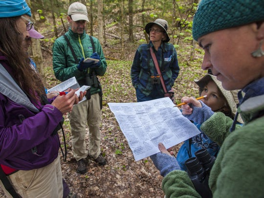 Kim Guertin, right, of Audubon Vermont, examines a checklist as she participates in the nonprofit's annual Birdathon fundraiser in Huntington on Thursday.