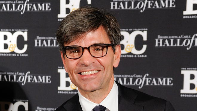 """This Oct. 20, 2014 photo shows George Stephanopoulos at the 24th Annual Broadcasting and Cable Hall of Fame Awards in New York. Stephanopoulos has apologized for not notifying his employer and viewers about major contributions he made to the Clinton Foundation. ABC's news division said May 15, that """"we stand behind him."""""""