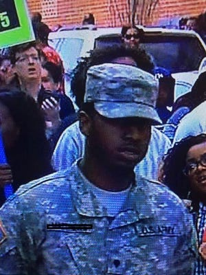 """A soldier who was shown wearing his uniform at a protest in Baltimore, Maryland, last week was """"not actively participating"""" but a victim of """"bad timing,"""" officials said."""