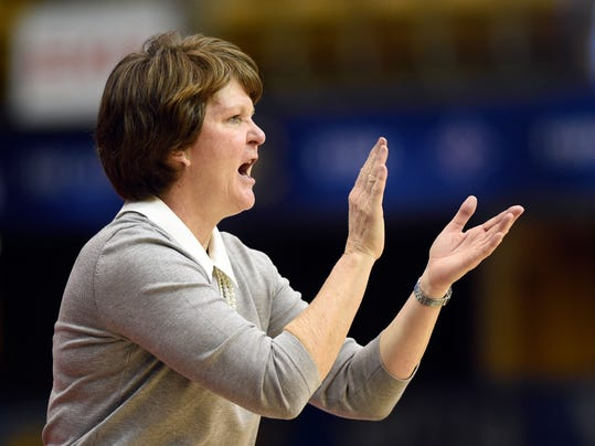 FILE - In this March 4, 2018, file photo, Mercer head coach Susie Gardner cheers on her team in the second half of an NCAA college basketball game against East Tennessee State, in the Southern Conference tournament championship, in Asheville, N.C. Host Georgia will try for its first win in the NCAA Tournament since 2013 when it faces Mercer, coached by former Georgia player Susie Gardner, on Saturday, March 17. (AP Photo/Kathy Kmonicek, File)