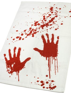 Thinkgeek.com carries the Blood Bath Bloody Hand Towel for $15, complete with two sickly hand prints.