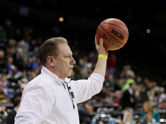 Michigan State's Head Coach Tom Izzo prepares to throw a ball during practice for the NCAA college basketball tournament in Spokane, Wash., Wednesday, March 19, 2014. Michigan State plays against Delaware in a second-round game on Thursday. (AP Photo/Young Kwak)