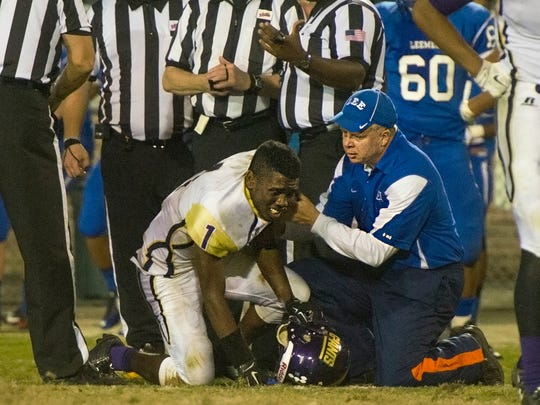 Waynesboro's Michael Brown is tended to by a member