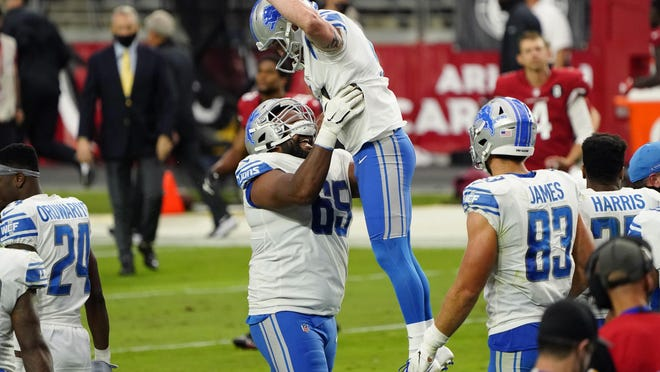 Detroit Lions kicker Matt Prater (5) celebrates after kicking the game winning field goal with teammate Tyrell Crosby (65)  during the second half of an NFL football game against the Arizona Cardinals, Sunday, Sept. 27, 2020, in Glendale, Ariz. The Lions won 26-23.