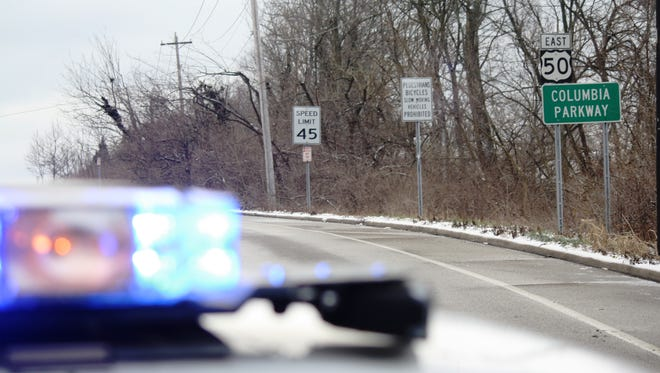 A Cincinnati police officer blocks eastbound Columbia Parkway Monday Morning after about 10 cars were involved in separate crashes on the road.