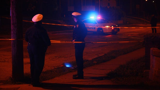Police investigate a shooting in Walnut Hills early Tuesday.