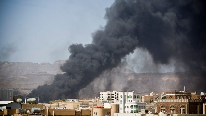 Smoke rises after a Saudi-led airstrike hit a suspected munitions storage site in Yemen's capital, Sanaa, on May 12.