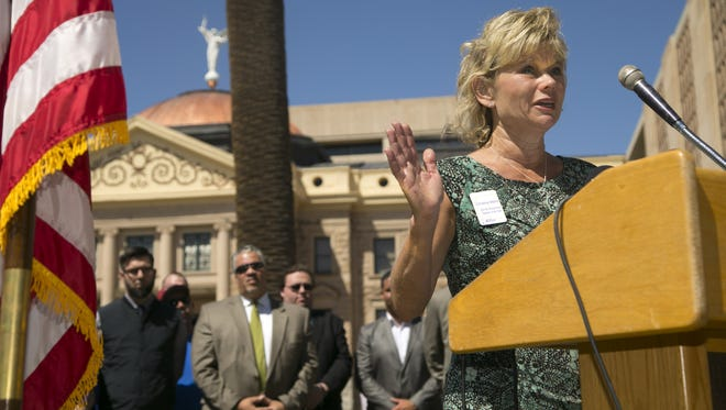 Chaparral High School teacher Christine Marsh, the 2016 Arizona teacher of the year, talks at the Capitol during a press conference announcing the Proposition 123 GO campaign, which encouraged voters to support the education-funding measure.