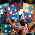 Clinton campaign signs are held as votes are cast during the second day of the Democratic National Convention in Philadelphia , Tuesday, July 26, 2016. (AP Photo/Paul Sancya)