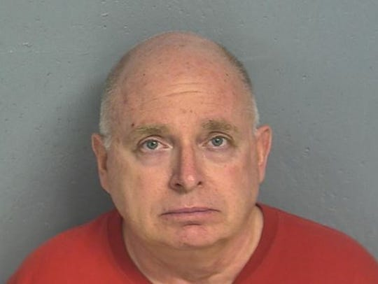 Daniel F. Rowland, as pictured in a mugshot from Friday,