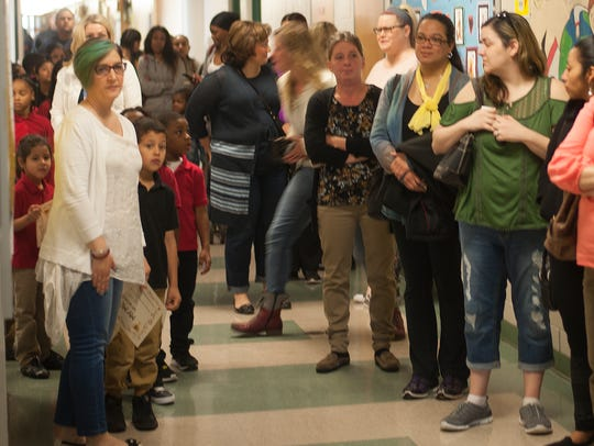 Mothers line up to enter the cafeteria at Johnstone