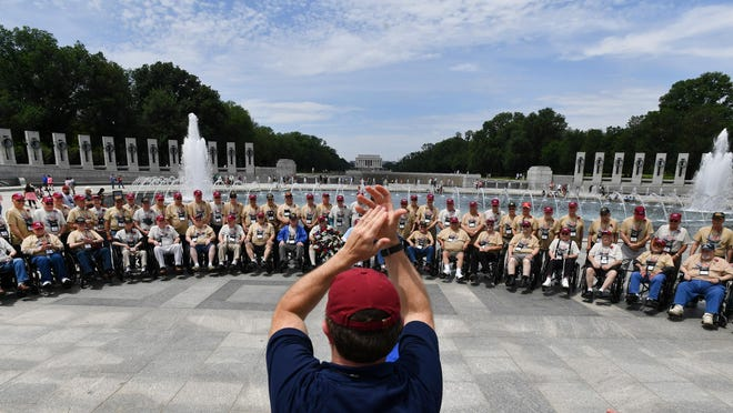 Greater Peoria Honor Flight veterans gather for a photo at the World War II Memorial in Washington, D.C., on Thursday, May 23, 2019.