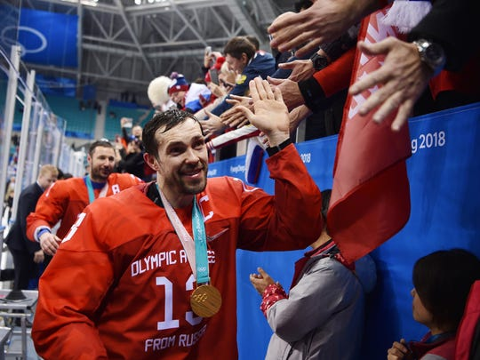Feb 24, 2018; Gangneung, South Korea; Pavel Datsyuk celebrates with fans as he leaves the ice after the men's ice hockey gold medal game against Germany during the Pyeongchang 2018 Olympic Winter Games at Gangneung Hockey Centre.