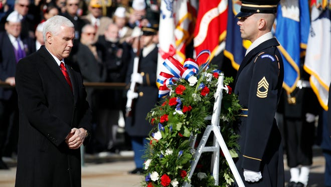 Vice President Mike Pence pauses after placing a wreath at the Tomb of the Unknown Soldier during a ceremony at Arlington National Cemetery on Veterans Day, Saturday, Nov. 11, 2017 in Washington.