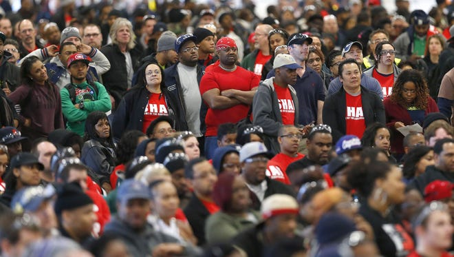 Members of the United Auto Workers listen to Chrysler Group LLC Chairman and CEO Sergio Marchionne speaks at a news conference to celebrate the production of the 2015 Chrysler 200 at the Sterling Heights Assembly Plant in Sterling Heights on Friday, March 14, 2014.