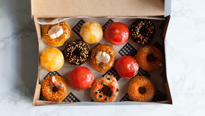 In D.C. and suburb Falls Church, Va., Astro Doughnuts & Fried Chicken offers these assorted Halloween mini doughnuts through October 31. Find flavors like chocolate glazed, crème brûlée, and pumpkin glazed.