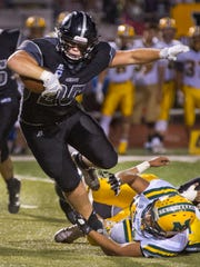 Oñate fullback Forest McKee breaks the shoestring tackle