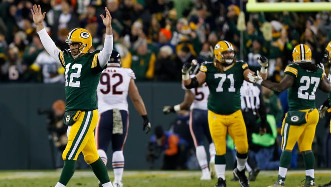 Green Bay Packers quarterback Aaron Rodgers (12) celebrates a touchdown during the first half against the Chicago Bears.