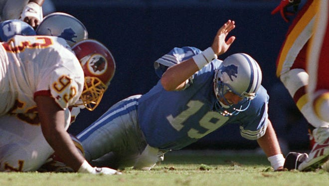 Detroit Lions QB Scott Mitchell pounds the ground in frustration after losing the second of two fumbles in a loss to the Washington Redskins in 1995.