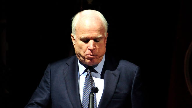 Sen. John McCain becomes emotional after sharing memories about Fred Thompson during Thompson's memorial service at War Memorial Auditorium on Friday, Nov. 6, 2015 in Nashville, Tenn.