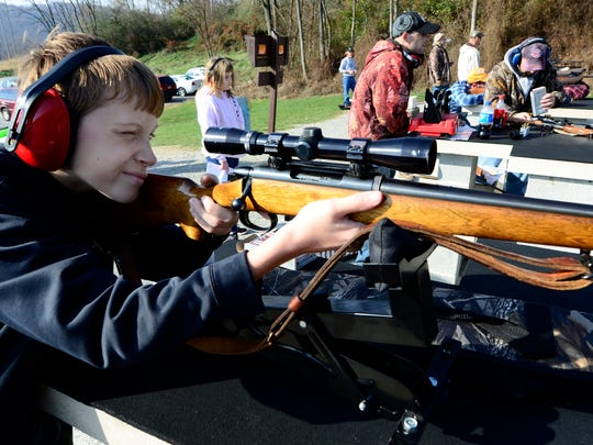 Jordan Lashley, 11 of Manchester, sights in his .243 Remington at the State Game Lands 242 shooting range on Old York Road near Dillsburg, Thursday, Nov. 26, 2015. Jordan and his father Dale will be hunting in Erie on opening day of Pennsylvania's annual firearms deer season, Monday. Nearly 1 million hunters take part in the PA traditional deer season. (John A. Pavoncello - The York Dispatch)