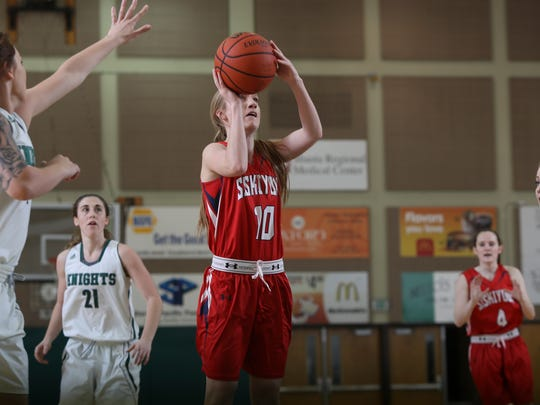 College of the Siskiyous sophomore Hannah Thompson (10) shoots in a game against Shasta.