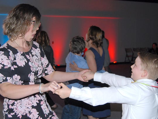 The annual Mother-Son Dance hosted by PenMet Parks at the Gig Harbor Boys & Girls Club takes place on Saturday.