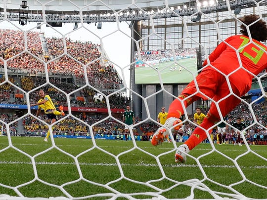 Sweden's Andreas Granqvist scores his side' second goal on a penalty, during the group F match between Mexico and Sweden, at the 2018 soccer World Cup in the Yekaterinburg Arena in Yekaterinburg, Russia, Wednesday, June 27, 2018. (AP Photo/Martin Meissner)