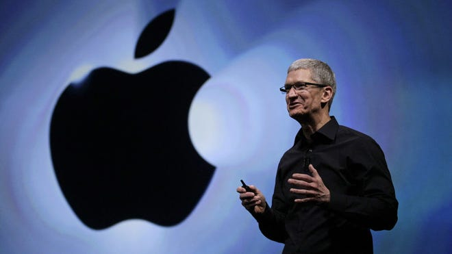 FILE - In this Wednesday, Sept. 12, 2012, file photo, Apple CEO Tim Cook speaks following an introduction of the new iPhone 5 in San Francisco. Apple is emerging as a gentler, cuddlier corporate citizen in the year after the death of CEO and co-founder Steve Jobs. CEO Tim Cook's announcement that the company is moving a Mac production line to the U.S. is just the latest step in a charm offensive designed to soften Apple's image. (AP Photo/Eric Risberg) ORG XMIT: NYBZ181