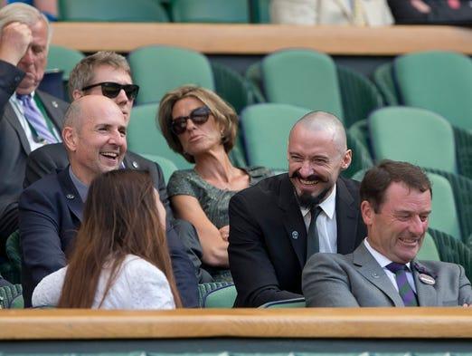 Hugh Jack City. Movie actor Hugh Jackman (right) speaks with 2013 Wimbledon champion Marion Bartoli (bottom left) during the match between Rafael Nadal and Martin Klizan.
