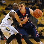 Forward Tomasz Gielo drives the ball around Missouri guard Terrence Phillips (1) on Wednesday. Ole Miss believes Vanderbilt will be a tough opponent Saturday despite the Commodores' early-season struggles.
