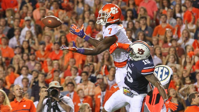 Clemson wide receiver Mike Williams (7) jumps for a catch near Auburn's Joshua Holsey (15) during the second quarter at Jordan-Hare Stadium in Auburn, Alabama. The play helped set up a touchdown by running back Wayne Gallman (9) that gave Clemson a 7-3 lead.