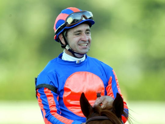 Joe Bravo smiles after riding Lion Heart to victory in the 2004 Haskell Invitational at Monmouth Park.