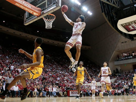 Indiana forward Justin Smith (3) goes to the basket in front of Wichita State guard Samajae Haynes-Jones (4) in the second half of an NCAA college basketball game in the third round of the NIT tournament, in Bloomington, Ind., Tuesday, March 26, 2019. Wichita State won 73-63. (AP Photo/AJ Mast)