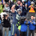 Jan 18, 2015; Seattle, WA, USA; Seattle Seahawks tight end Luke Willson (82) celebrates his two-point conversion catch against the Green Bay Packers during the fourth quarter in the NFC Championship Game at CenturyLink Field.