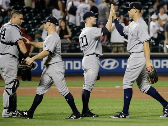 New York Yankees' Aaron Judge, right, celebrates with